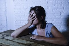 Young beautiful sad and depressed woman looking wasted and frustrated suffering pain and depression feeling low and break down Stock Photo