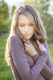 Young beautiful sad girl looking down, outdoor portrait Stock Photos