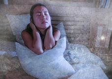 Sad and depressed Asian Korean woman in bed suffering depression anxiety and insomnia feeling miserable. Young beautiful sad and worried Asian Korean woman awake Royalty Free Stock Images