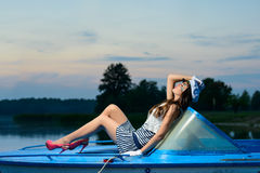 Young beautiful sailor woman on the boat Royalty Free Stock Image