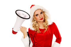 Young beautiful santa woman holding megaphone Stock Photos