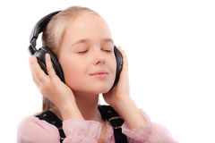 Young beautiful schoolgirl listens Royalty Free Stock Photography