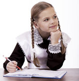 Young beautiful schoolgirl sitting at a desk Royalty Free Stock Images