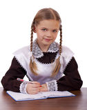 Young beautiful schoolgirl sitting at a desk Stock Photography