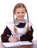 Young beautiful schoolgirl sitting at a desk Royalty Free Stock Photo