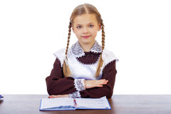 Young beautiful schoolgirl sitting at a desk Royalty Free Stock Photography