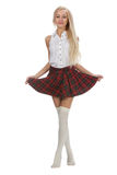 Young and beautiful schoolgirl is wearing a traditional uniform Royalty Free Stock Photos