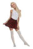 Young and beautiful schoolgirl is wearing a traditional uniform Stock Photography