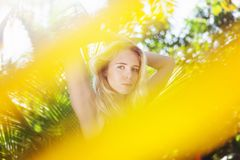 Young beautiful sensual girl on the background of a tropical garden, beauty and nature concept. Young beautiful sensual girl on background of a tropical garden royalty free stock photos
