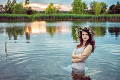 Young beautiful sensual woman with wreath in the water Royalty Free Stock Image