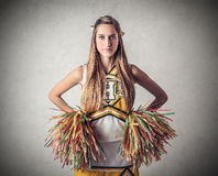 Young beautiful serious cheer-leader Stock Photography
