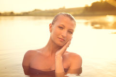 Young beautiful sexi smiling lady in water Royalty Free Stock Photos