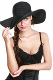 Young beautiful sexual woman in a hat Stock Images