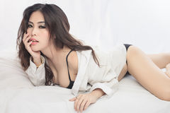 Young beautiful Sexy Asian woman  lying in bed. Young beautiful Sexy Asian woman Royalty Free Stock Images
