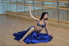 Young Beautiful Sexy Belly dancer in arabic costume dancing on a floor Royalty Free Stock Photos