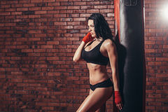 Young beautiful sexy boxer woman with red boxing Royalty Free Stock Photography