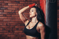 Young beautiful sexy boxer woman with red boxing Royalty Free Stock Image
