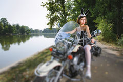 Young beautiful sexy bunny female on cruiser motorcycle Stock Photo