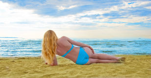 Young, beautiful and sexy girl on the beach. Royalty Free Stock Photos