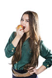 Young beautiful girl with dark curly hair, holding big apple to enjoy the taste and are dieting, smile. Young beautiful girl with dark curly hair, holding big Stock Images