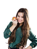 Young beautiful girl with dark curly hair, holding big apple to enjoy the taste and are dieting, smile. Young beautiful girl with dark curly hair, holding big Stock Photo