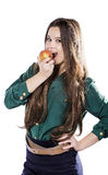 Young beautiful girl with dark curly hair, holding big apple to enjoy the taste and are dieting, smile. Young beautiful girl with dark curly hair, holding big Royalty Free Stock Photography