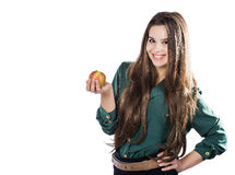 Young beautiful girl with dark curly hair, holding big apple to enjoy the taste and are dieting, smile. Young beautiful girl with dark curly hair, holding big Royalty Free Stock Photos