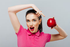 Young beautiful sexy girl with dark hair, holding big red apple to enjoy the taste and are dieting, healthy eating and Stock Image