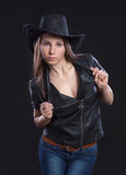 Young beautiful sexy girl in fur waistcoat and  cowboy hat Stock Images