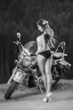 Young beautiful sexy girl standing by the motorcycle Royalty Free Stock Image