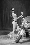 Young beautiful sexy girl standing by the motorcycle Royalty Free Stock Images