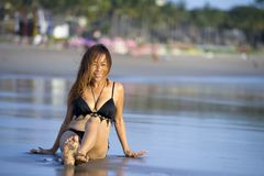 Young beautiful and sexy happy Asian woman smiling relaxed having fun on tropical beach in Bali Asia. Portrait of young beautiful and sexy happy Asian woman Stock Photography