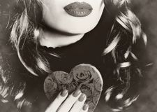 Young beautiful sexy pretty woman holding a heart makeup valentine love romance sepia vintage retro Royalty Free Stock Photo