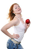 Young beautiful sexy red woman. Young beautiful sexy red smiling and eating red apple woman on the white background Royalty Free Stock Photography