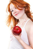 Young beautiful sexy red woman. Young beautiful sexy red smiling woman with apple on the white background Royalty Free Stock Photo