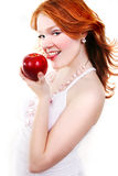 Young beautiful sexy red woman. Young beautiful sexy red smiling woman with apple on the white background Stock Photo