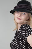 Young beautiful sexy smiling blonde woman. In a black hat looking at camera close-up Royalty Free Stock Image
