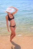 Young beautiful tanned blond woman in bikini stock photo