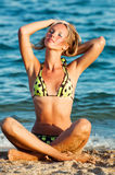 Young beautiful tanned blond woman in bikini Royalty Free Stock Images