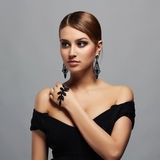 Young beautiful sexy woman.Beauty girl in black dress and jewelry. Young beautiful sexy woman.Beauty girl with short hair and make-up.elegant lady in black dress Royalty Free Stock Image