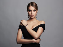 Young beautiful sexy woman.Beauty girl in black dress and jewelry. Young beautiful sexy woman.Beauty girl with short hair and make-up.elegant lady in black dress Stock Photos