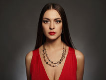 Young beautiful sexy woman.Beauty girl wearing jewelry.elegant lady in red dress Royalty Free Stock Photos