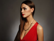 Young beautiful sexy woman.Beauty girl wearing jewelry.elegant lady in red dress. Close-up fashion portrait of young beautiful sexy woman.Beauty girl wearing Stock Images