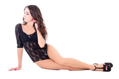 Young beautiful sexy woman in black lace lingerie sitting isolat Stock Images