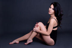 Young beautiful sexy woman in black lingerie sitting on the floo Stock Photo