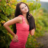 Young beautiful woman in grapes. Long hair royalty free stock photography