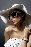 Young beautiful sexy woman with hat and sunglasses Royalty Free Stock Photo