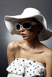 Young beautiful sexy woman with hat and sunglasses Stock Images