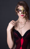 Young beautiful sexy woman in lingerie and mask over grey Stock Photos