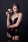 Young beautiful sexy woman in lingerie posing with mask over gre Royalty Free Stock Photo